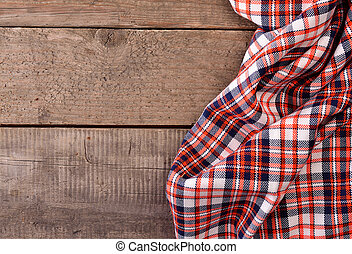 Table cloth on wood - Checkered table cloth on an old wooden...