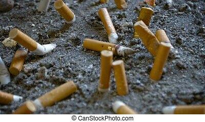 Cigarette Butts Extinguished in Sand - Video 1080p - Closeup...