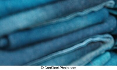 Neat Stacks of Folded Denim Trousers - Video 1080p - Many...