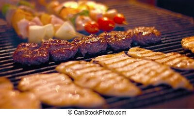 Assorted Meats on a Turkish Street Vendors Barbecue Grill -...