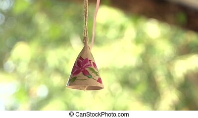 wooden bell with a picture