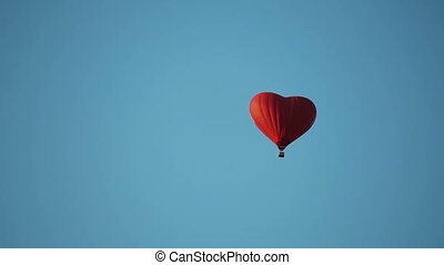 aerostat heart in the blue sky - Hot air balloon in the form...