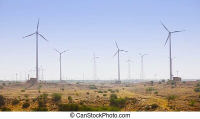 Huge Wind Farm on an Arid Plain - FullHD video - Rows of...
