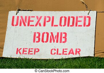 Warning sign for unexploded bomb