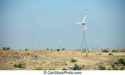 Rows of Wind Turbines on a Dry Plain - Video 1080p -...