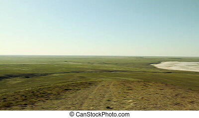 green steppe and salt lake Baskunchak at sunny day