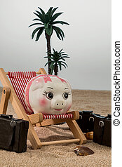 piggy bank in a deckchair - a piggy bank is in a deckchair....
