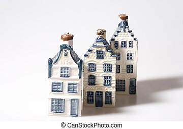 Three Delft blue houses - Three miniature stone houses in...