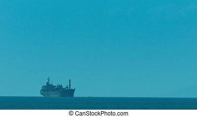 Enormous Commercial Tanker against the Distant Horizon -...