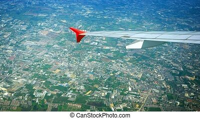 Aerial Cityscape with Plane's Wing in Frame - Video 1080p -...