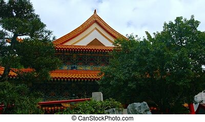 Gardens and Façade of Wong Tai Sin Temple in Hong Kong,...