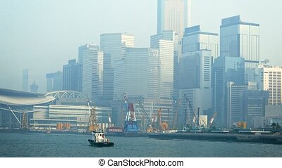 Modern, Urban Buildings in the Fog over a Busy Harbor -...