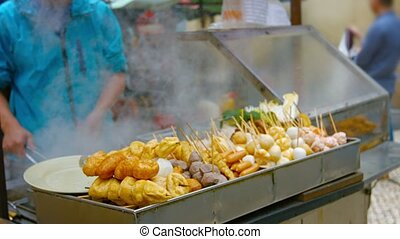 Traditional Asian Street Foods at an Outdoor Vendors Stand -...