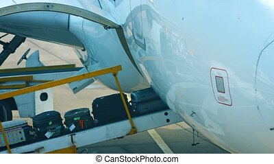 Luggage Being Loaded onto an Airliner - FullHD video -...