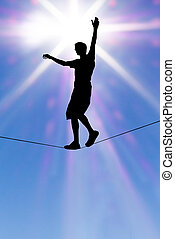 Silhouette of man on the rope concept of risk taking...