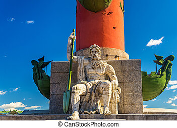 Statue at a Rostral column in Saint Petersburg - Russia