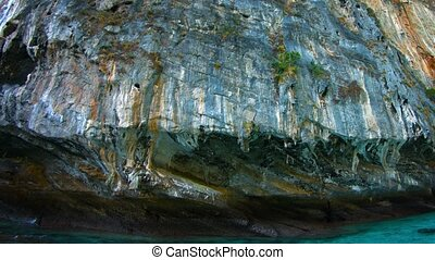 Massive Limestone Cliff, Undercut by Erosion from Continuous...
