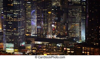 Beautifully Lit, Modern Towers of a Crowded City at Night -...