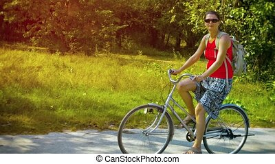 Adventurous Tourist Riding a Rented Bicycle - FullHD video -...