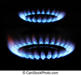 gas - blue flame of gas over black background...