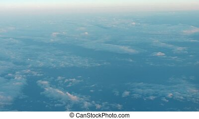 Peaceful view of fluffy clouds from an airborne perspective...