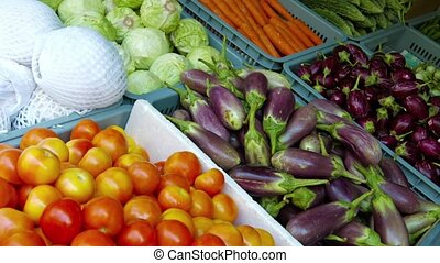 Newly Harvested Vegetables Displayed in a Public Market
