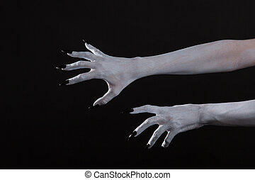 Scary pale ghost hands with black nails