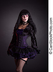 Halloween witch in purple costume - Halloween witch in...