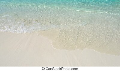 Small Waves Gently Washing a Beach in the Similan Islands of...