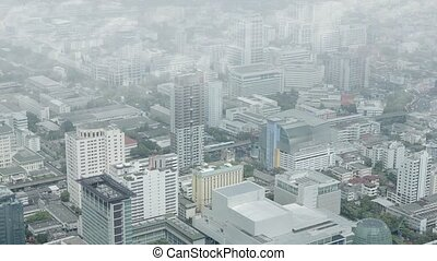 Clouds Scooting By, Viewed from a Skyscraper in Bangkok,...