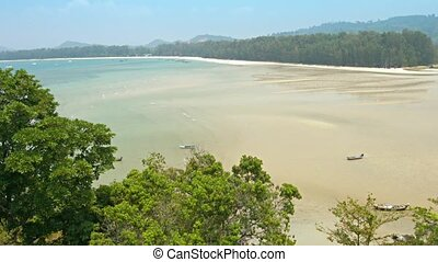 Overlooking a Wide, Sandy, Tropical Beach at Low Tide -...