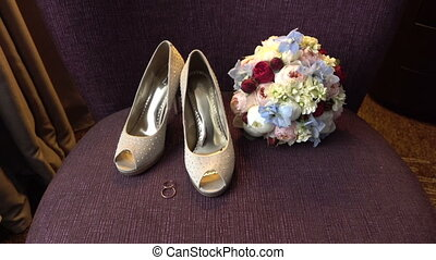 Wedding rings, bouquet and bride shoes