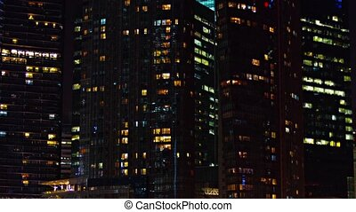 Commercial Highrise Buildings at Night in Selective Focus -...