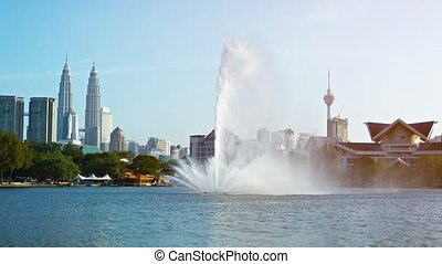 Fountain Spraying Skyward in a City Park - FullHD video -...