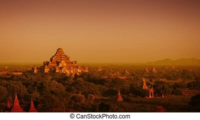 Landscape in Bagan, Myanmar, with the spires of ancient,...