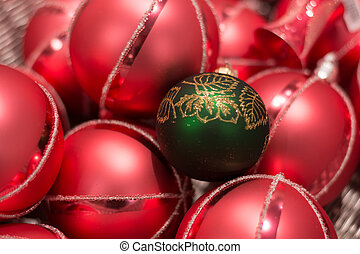 red Christmas baubles with a green - Close-up abundance of...