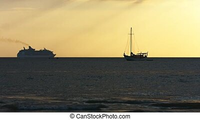Sailboat and Cruise Ship on a Tropical Sunset Horizon -...