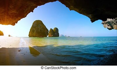 Giant Limestone Formations in the Tropical Sea, from a Cave