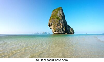 Massive Limestone Rock Formations Towering over Tropical...