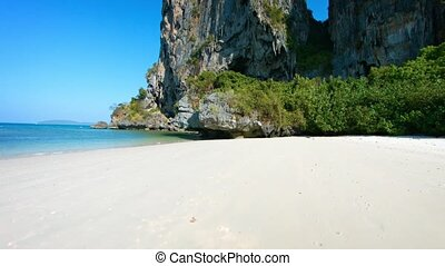 Limestone Seacliffs, Rising from a Tropical Beach - Video...