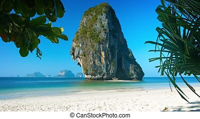 Vertical Limestone Formation over Tropical Beach - Video...
