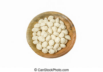 Sesame Sugar Candy (Revadi) in a bowl