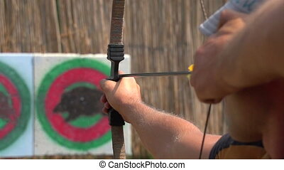 man shoots a bow at a target, Slow Motion