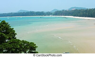 Beautiful, exotic, tropical beach at low tide, under a bright blue sumer sky in southern Thailand. Top view