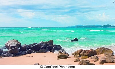 Small Waves Break over Boulders at a Tropical Beach - Video...