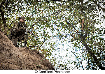 Soldier in the battlefield - Picture of young soldier in the...