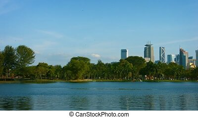 Fountains and Greenery at an Urban Lake in Kuala Lumpur -...