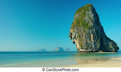 Enormous Rock Towers over Sandy Tropical Beach - 1920x1080...