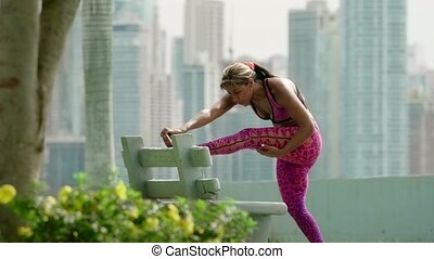 Woman Doing Stretching Before Sports Training At Morning -...