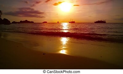Cruise Ships and Tour Boats on the Horizon at Sunset -...